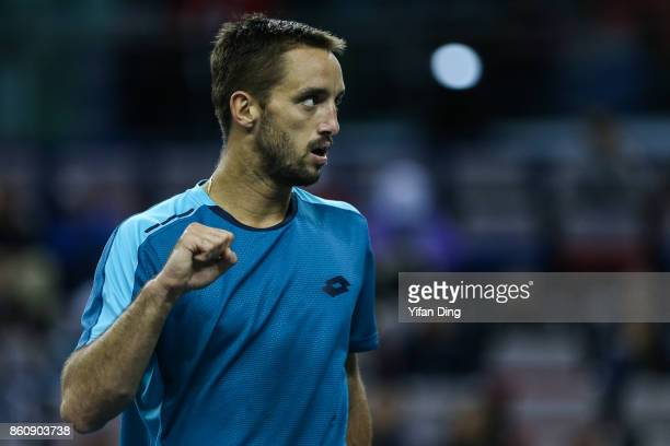 Viktor Troicki of Serbia reacts after winning a point during the Men's singles quarter final mach against Juan Martin del Potro of Argentina on day...