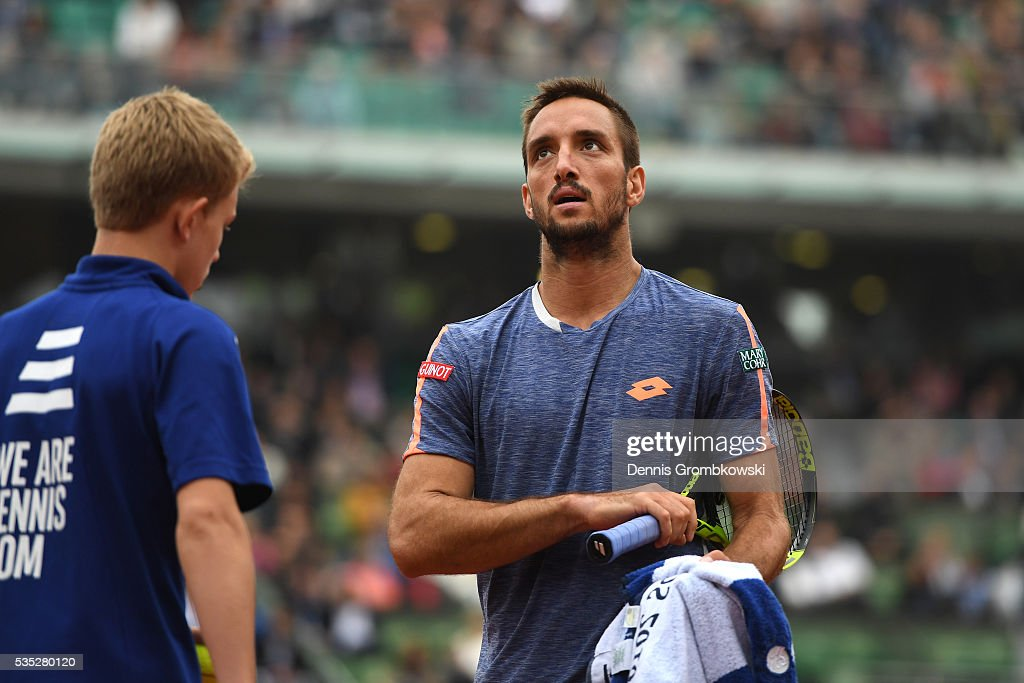 <a gi-track='captionPersonalityLinkClicked' href=/galleries/search?phrase=Viktor+Troicki&family=editorial&specificpeople=553829 ng-click='$event.stopPropagation()'>Viktor Troicki</a> of Serbia reacts during the Men's Singles fourth round match against Stan Wawrinka of Switzerland on day eight of the 2016 French Open at Roland Garros on May 29, 2016 in Paris, France.