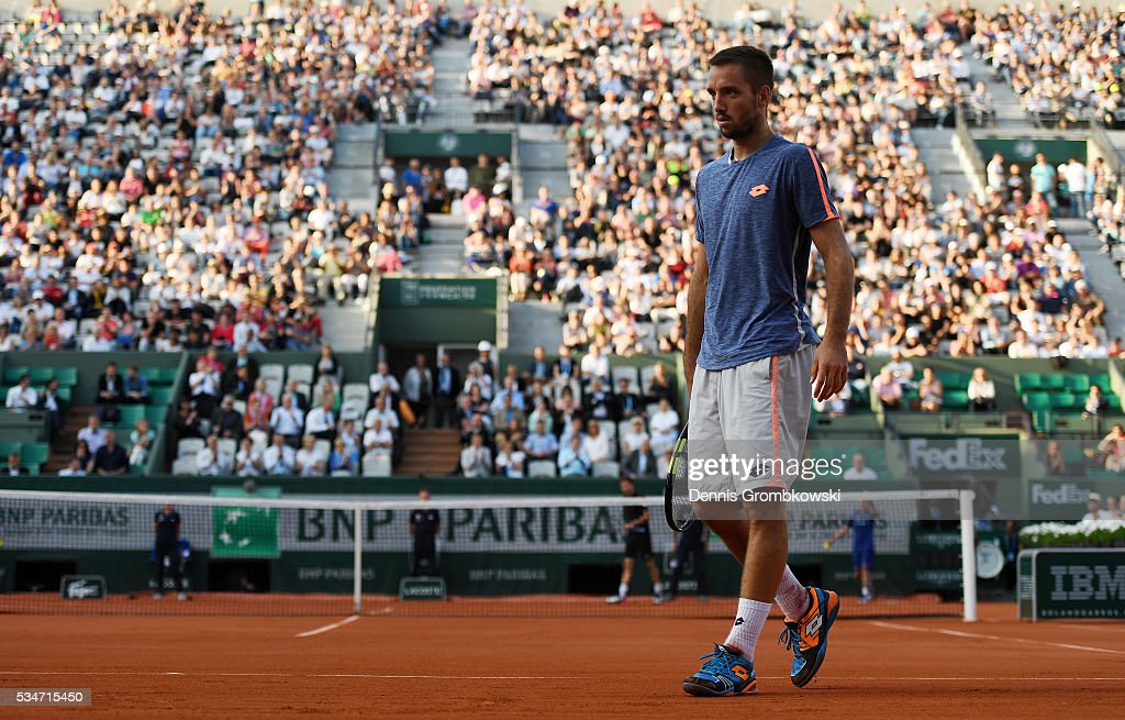 <a gi-track='captionPersonalityLinkClicked' href=/galleries/search?phrase=Viktor+Troicki&family=editorial&specificpeople=553829 ng-click='$event.stopPropagation()'>Viktor Troicki</a> of Serbia reacts during the Men's Singles third round match against Gilles Simon of France on day six of the 2016 French Open at Roland Garros on May 27, 2016 in Paris, France.