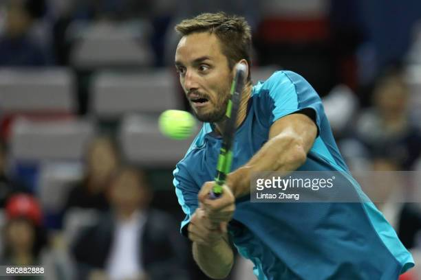 Viktor Troicki of Serbia returns a shot during the Men's singles quarter final mach against Juan Martin Del Potro of Argentina on day six of 2017 ATP...