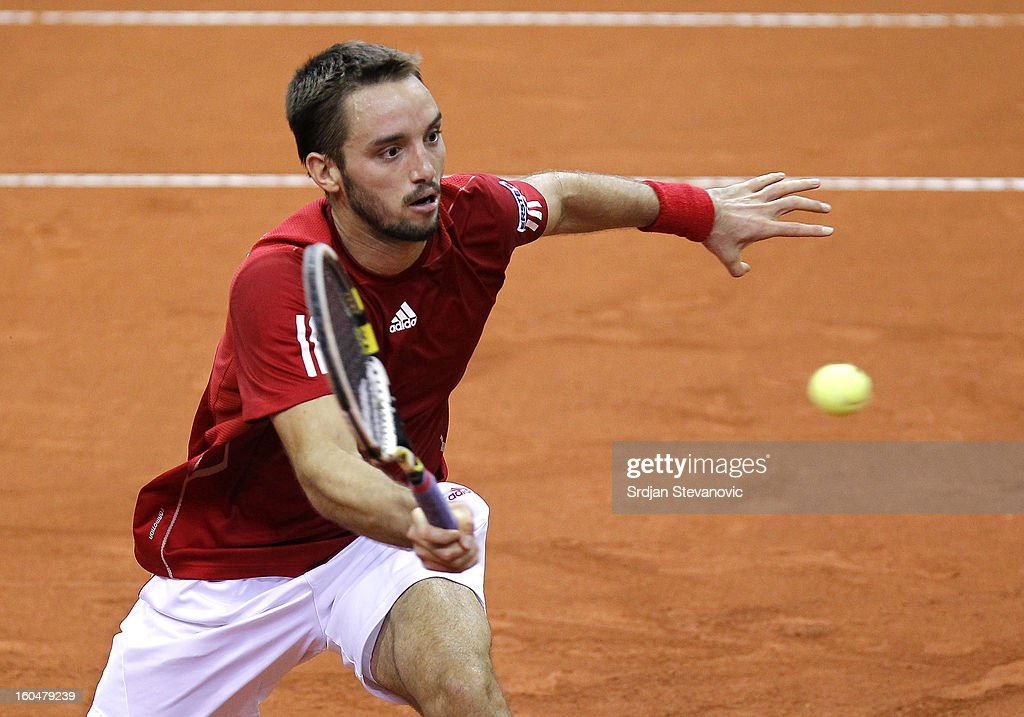 Viktor Troicki of Serbia returns a shot to David Goffin of Belgium during the Davis Cup singles first round match between Belgium and Serbia, at Spirou dome February 01, 2013 in Charleroi, Belgium.