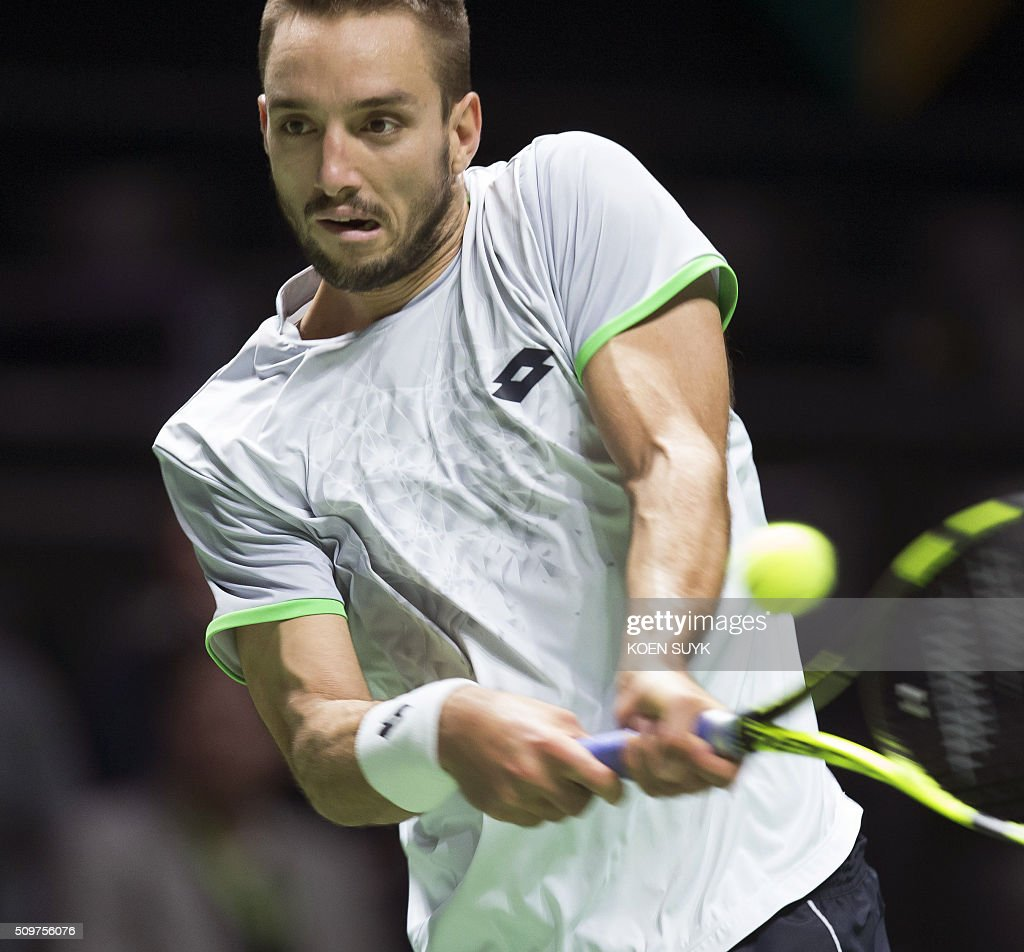 Viktor Troicki of Serbia returns the ball to Nicolas Mahut of France in the quarterfinals of the ABN AMRO World Tennis Tournament in Rotterdam, on February 12, 2016. Viktor Troicki of Serbia returns the ball to Nicolas Mahut of France in the quarterfinals of the ABN AMRO World Tennis Tournament in Rotterdam, Netherlands, 12 February 2016. ANP KOEN SUYK netherlands out - belgium out / AFP / ANP / Koen Suyk / Netherlands OUT
