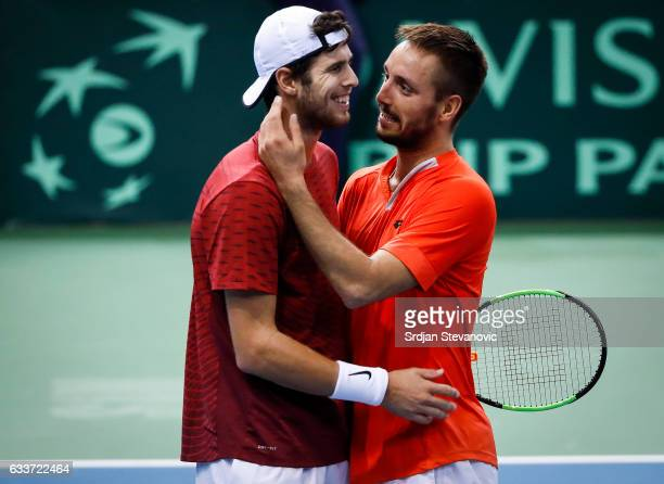 Viktor Troicki of Serbia salutes Russia's tennis player Karen Khachanov after the Davis Cup World Group first round single match between Serbia and...