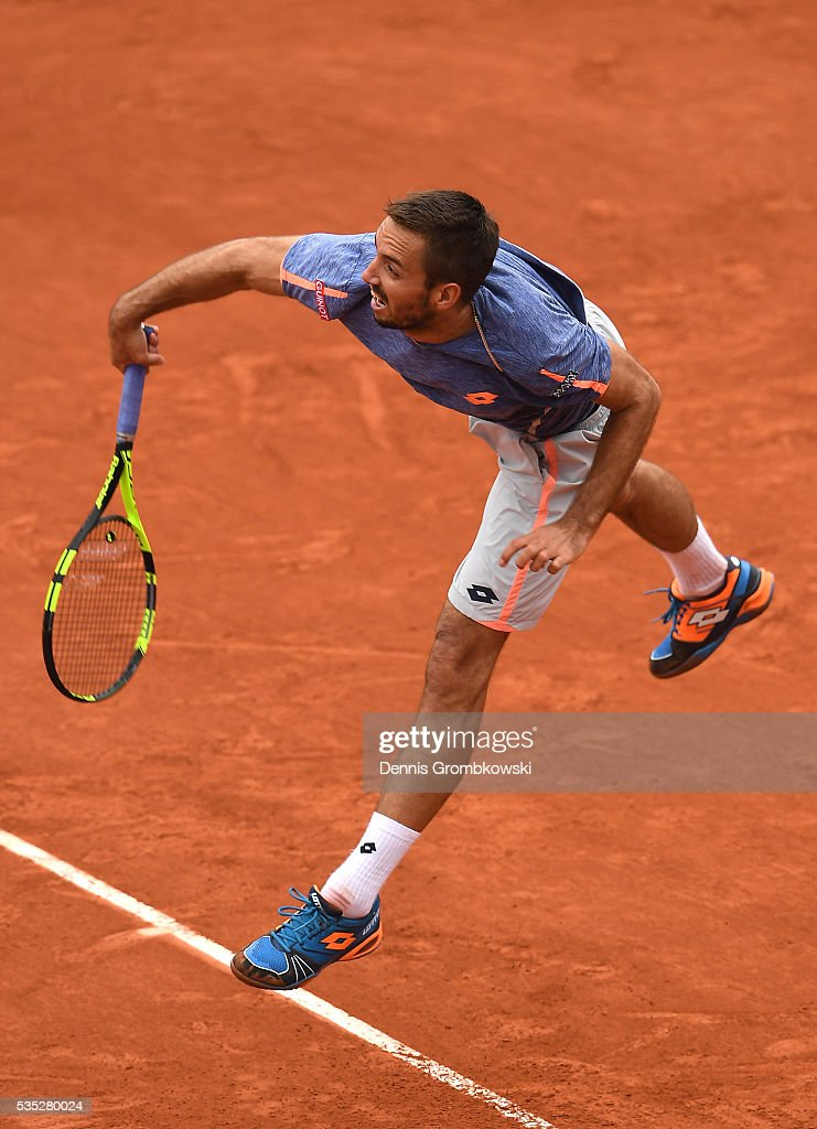<a gi-track='captionPersonalityLinkClicked' href=/galleries/search?phrase=Viktor+Troicki&family=editorial&specificpeople=553829 ng-click='$event.stopPropagation()'>Viktor Troicki</a> of Serbia serves during the Men's Singles fourth round match against Stan Wawrinka of Switzerland on day eight of the 2016 French Open at Roland Garros on May 29, 2016 in Paris, France.