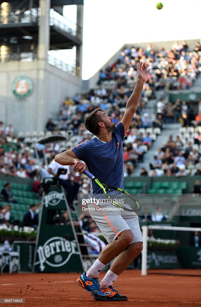 <a gi-track='captionPersonalityLinkClicked' href=/galleries/search?phrase=Viktor+Troicki&family=editorial&specificpeople=553829 ng-click='$event.stopPropagation()'>Viktor Troicki</a> of Serbia serves during the Men's Singles third round match against Gilles Simon of France on day six of the 2016 French Open at Roland Garros on May 27, 2016 in Paris, France.