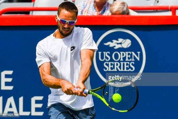 Viktor Troicki returns the ball during his first round match at ATP Coupe Rogers on August 7 at Uniprix Stadium in Montreal QC