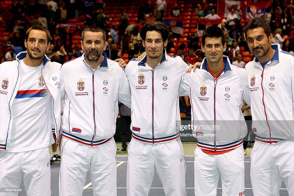<a gi-track='captionPersonalityLinkClicked' href=/galleries/search?phrase=Viktor+Troicki&family=editorial&specificpeople=553829 ng-click='$event.stopPropagation()'>Viktor Troicki</a>, Team Captain Bogdan Obradovic, Ilija Bozoljac, <a gi-track='captionPersonalityLinkClicked' href=/galleries/search?phrase=Novak+Djokovic&family=editorial&specificpeople=588315 ng-click='$event.stopPropagation()'>Novak Djokovic</a> and <a gi-track='captionPersonalityLinkClicked' href=/galleries/search?phrase=Nenad+Zimonjic&family=editorial&specificpeople=243242 ng-click='$event.stopPropagation()'>Nenad Zimonjic</a> of the Serbian team pose for photographers after defeating the US 3-1 during the Davis Cup tie between the United States and Serbia at Taco Bell Arena on April 7, 2013 in Boise, Idaho.