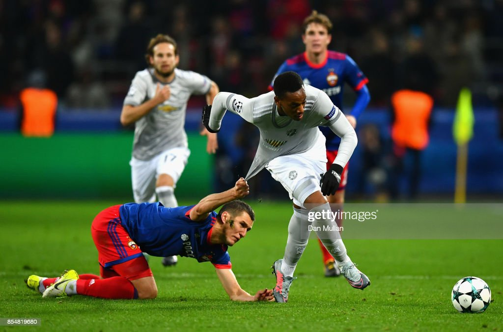 Viktor Vasin of CSKA Moscow pulls back Anthony Martial of Manchester United during the UEFA Champions League group A match between CSKA Moskva and Manchester United at WEB Arena on September 27, 2017 in Moscow, Russia.