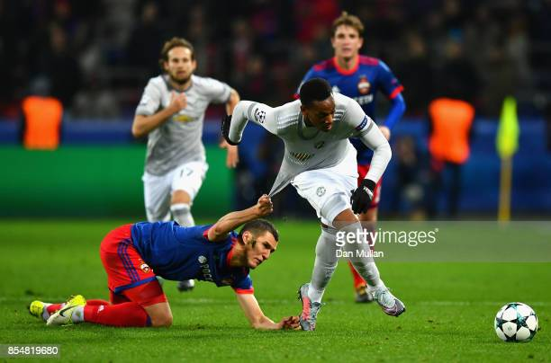 Viktor Vasin of CSKA Moscow pulls back Anthony Martial of Manchester United during the UEFA Champions League group A match between CSKA Moskva and...