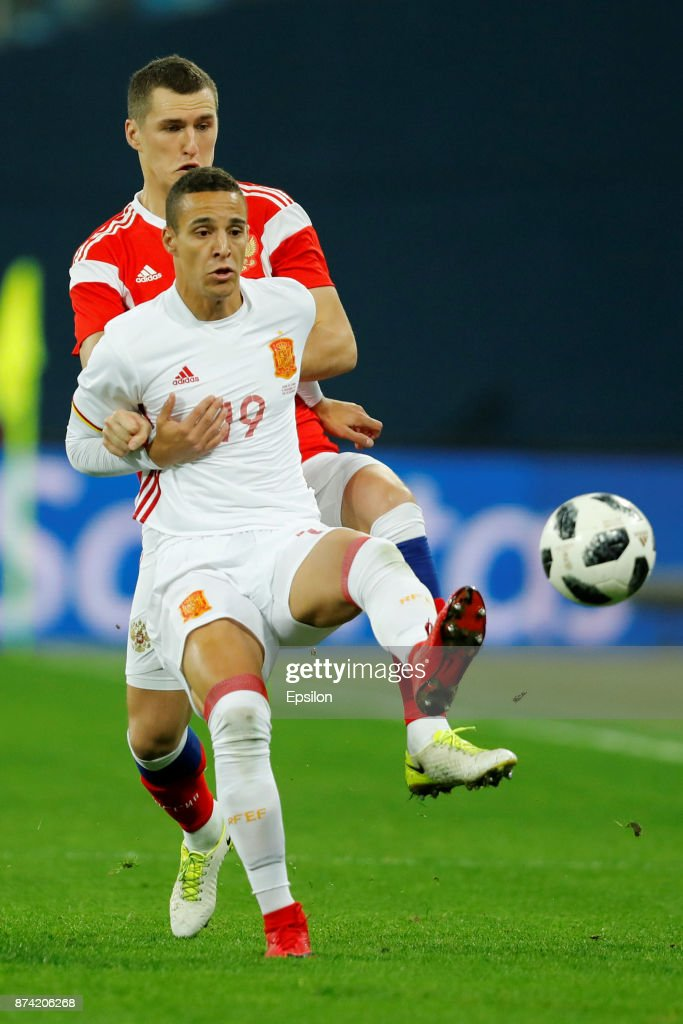 Viktor Vasin of Russia and Rodrigo (Front) of Spain vie for the ball during Russia and Spain International friendly match on November 14, 2017 at Saint Petersburg Stadium in Saint Petersburg, Russia.