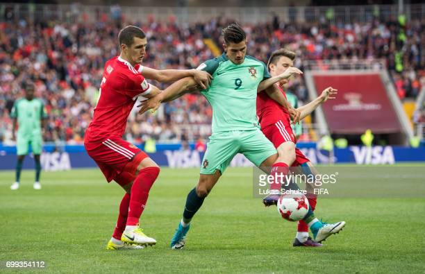 Viktor Vasin of Russia Andre Silva of Portugal and Aleksandr Golovin of Russia fight for the ball during the FIFA Confederations Cup Russia 2017...