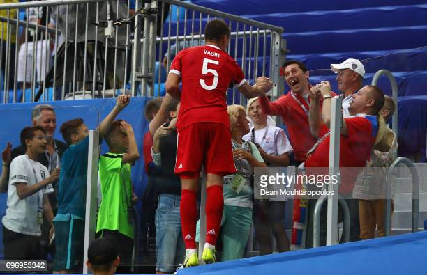 Viktor Vasin of Russia celebrates with a fan after the FIFA Confederations Cup Russia 2017 Group A match between Russia and New Zealand at Saint...