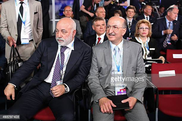 Viktor Vekselberg a Russian billionaire left and David Yakobashvili billionaire and chairman of Bioenergy Corp right wait for Russia's Prime Minister...
