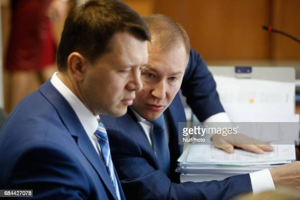 Viktor Yanukovych head of defence Vitalii Serdyuk talk to his colleague before the court hearing Obolon district court of Kyiv continues the first...