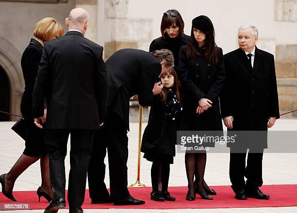 Viktor Yushchenko former president of Ukraine greets Ewa Kaczynska granddaughter of late Polish President Lech Kazcynski as her mother Marta...