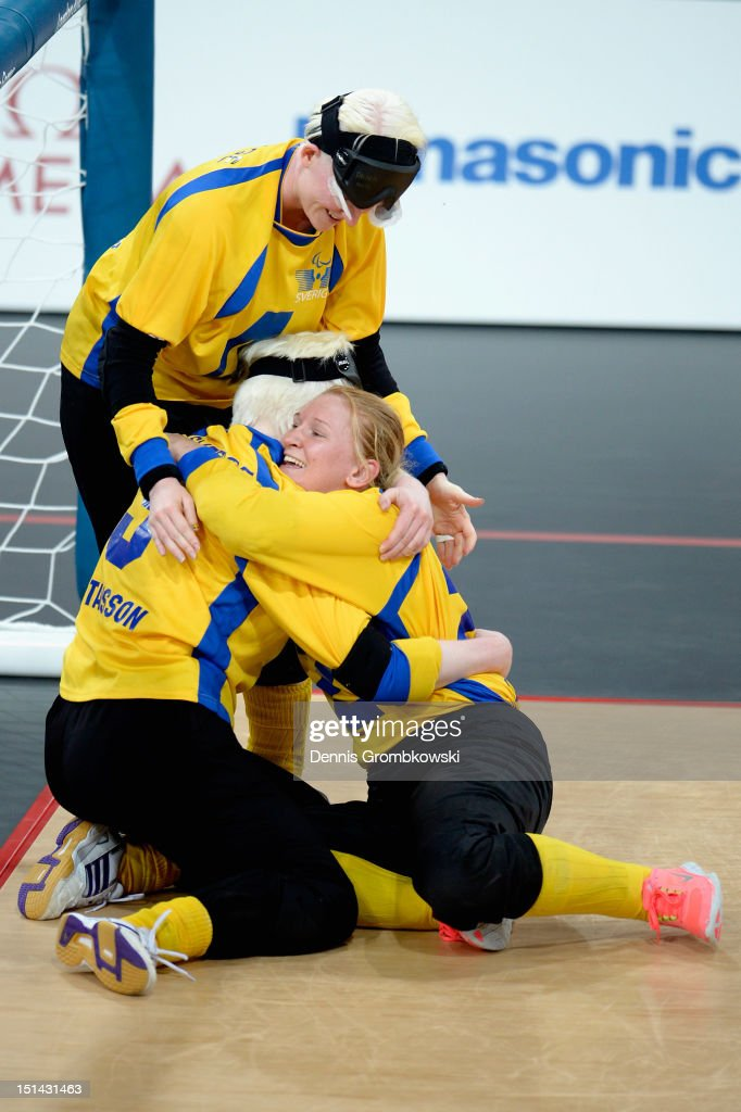 Viktoria Andersson of Sweden celebrates with her teammates <a gi-track='captionPersonalityLinkClicked' href=/galleries/search?phrase=Anna+Dahlberg&family=editorial&specificpeople=773718 ng-click='$event.stopPropagation()'>Anna Dahlberg</a> and Malin Gustavsson after winning their Women's Team Goalball Bronze Medal match against Finland on day 9 of the London 2012 Paralympic Games at The Copper Box on September 7, 2012 in London, England.