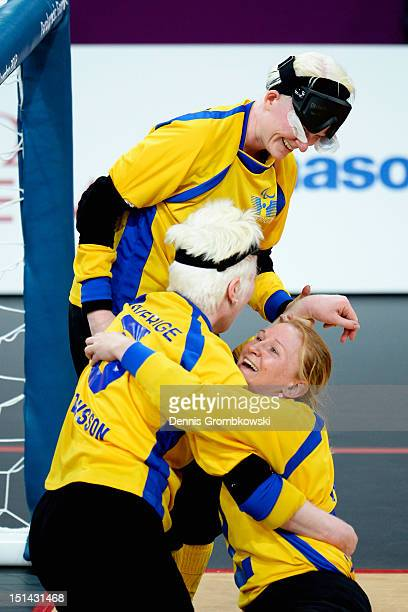 Viktoria Andersson of Sweden celebrates with her teammates Anna Dahlberg and Malin Gustavsson after winning their Women's Team Goalball Bronze Medal...