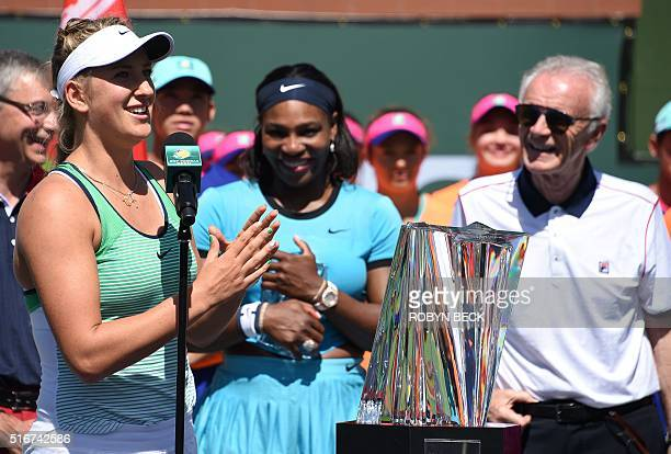 Viktoria Azaranka of Belraus speaks as Serena Williams of USA and Raymond Moore CEO of the Indian Wells Tennis Garden look on during the trophy...