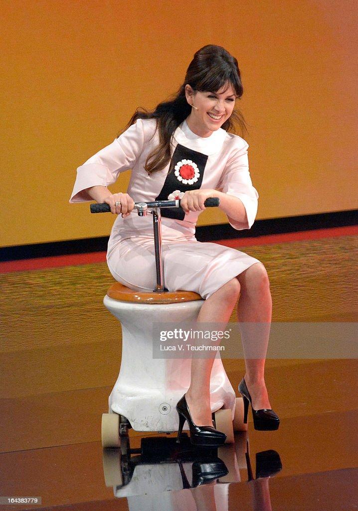 Viktoria Lauterbach seen riding a toilet during 'Wetten, dass..?' TV Show at Stadthalle on March 23, 2013 in Vienna, Austria.