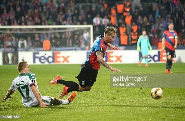 FC Viktoria Plzen's defender Frantisek Rajtoral is tackled by Rapd Wien's Christopher Dibon during the UEFA Europa League football match FC Viktoria...