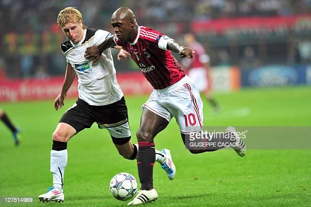 Viktoria Plzen's midfielder František Rajtoral fights for the ball with AC Milan's Dutch midfielder Clarence Seedorf during their Champions League...