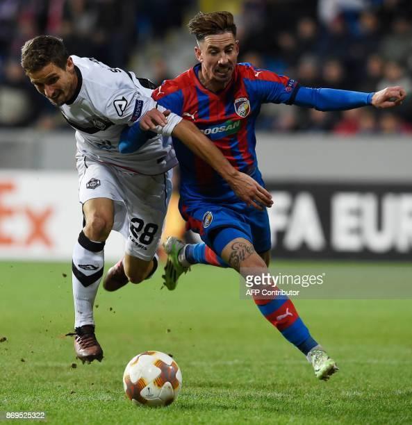 Viktoria Plzen's midfielder from Czech Republic Milan Petrzela and Lugano's Swiss defender Fulvio Sulmoni vie for the ball during the UEFA Europa...