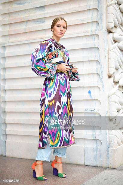 Viktoria Rader poses wearing an Yves Saint Laurent dress before the Arthur Arbesser show during the Milan Fashion Week Spring/Summer 16 on September...