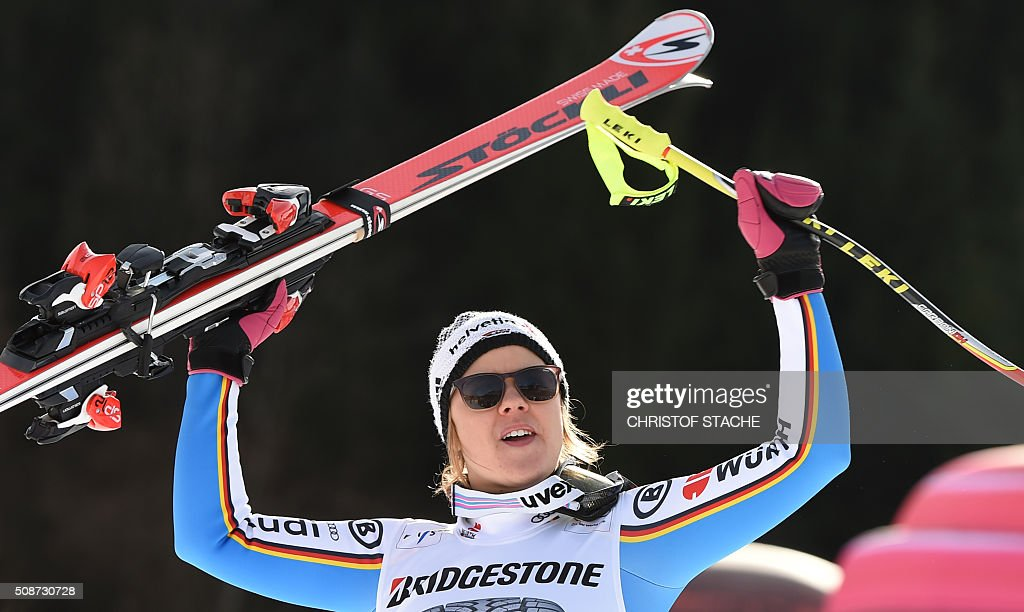 Viktoria Rebensburg from Germany celebrates during the winner ceremony after the ladies downhill competition race at the FIS Alpine Skiing World Cup in Garmisch-Partenkirchen, southern Germany, on February 6, 2016. Lindsey Vonn from USA won the competition, Fabienne Suter from Switzerland placed second and Viktoria Rebensburg from Germany placed third. / AFP / Christof STACHE