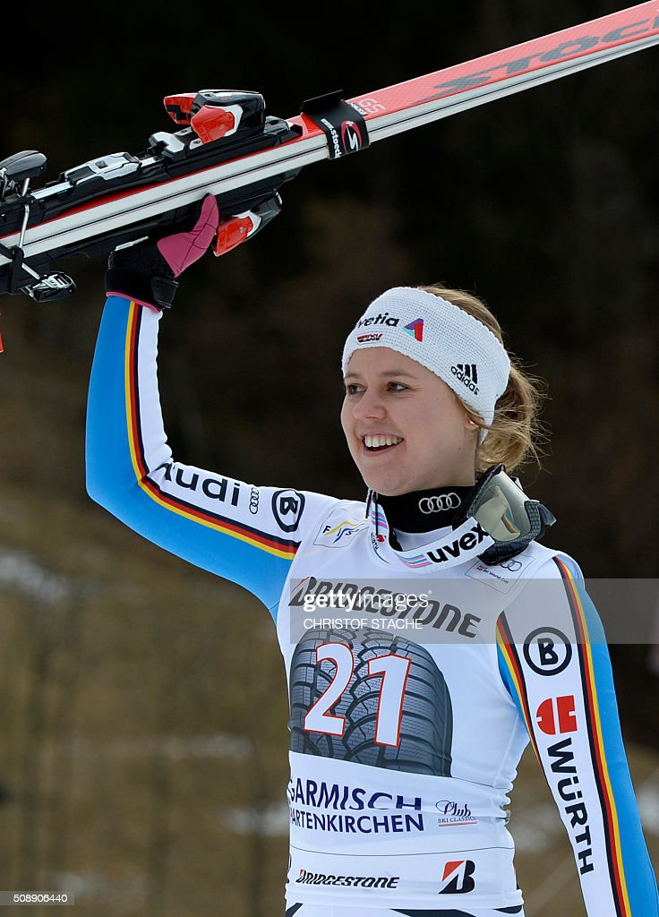 Viktoria Rebensburg from Germany celebrates during the winner ceremony of the Ladies Super G competition race at the FIS Alpine Skiing World Cup in Garmisch-Partenkirchen, southern Germany, on February 7, 2016. Lara Gut from Switzerland won the competition, Viktoria Rebensburg from Germany placed second and Lindsey Vonn from USA placed third. / AFP / Christof STACHE