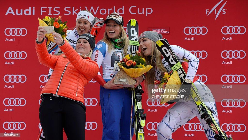 TOPSHOT Viktoria Rebensburg from Germany former Austrian skier Nicole Hosp Lara Gut from Switzerland and Lindsey Vonn from USA take a photo during...