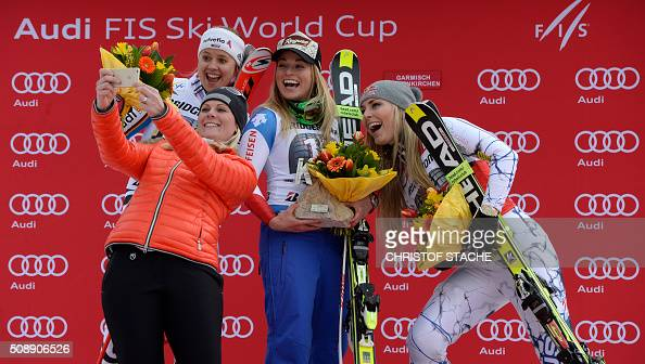 TOPSHOT Viktoria Rebensburg from Germany former Austrian skier Nicole Hosp Lara Gut from Switzerland and Lindsey Vonn from USA take a photo during...