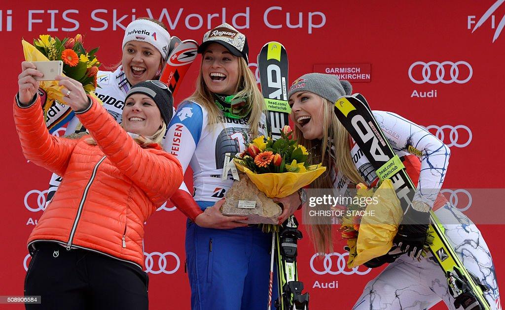 Viktoria Rebensburg from Germany former Austrian skier Nicole Hosp Lara Gut from Switzerland and Lindsey Vonn from USA take a photo during the winner...