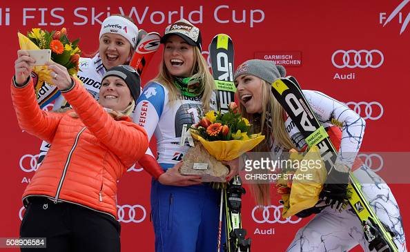 Viktoria Rebensburg from Germany former Austrian skier Nicole Hosp Lara Gut from Switzerland and Lindsey Vonn from USA take a photo during the winner...