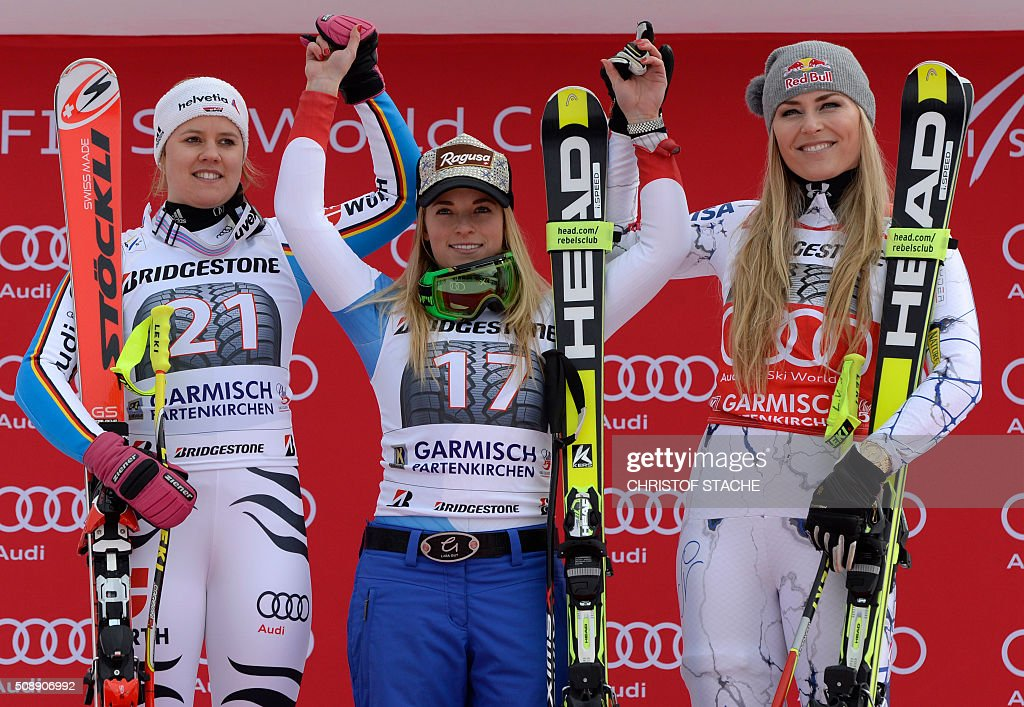 Viktoria Rebensburg from Germany, Lara Gut from Switzerland and Lindsey Vonn from USA pose during the winner ceremony of the Ladies Super G competition race at the FIS Alpine Skiing World Cup in Garmisch-Partenkirchen, southern Germany, on February 7, 2016. Lara Gut from Switzerland won the competition, Viktoria Rebensburg from Germany placed second and Lindsey Vonn from USA placed third. / AFP / Christof STACHE