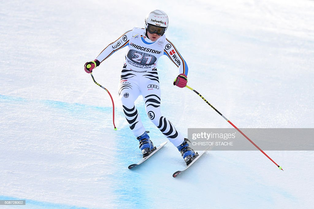 Viktoria Rebensburg from Germany races down the hill during the ladies downhill competition race at the FIS Alpine Skiing World Cup in Garmisch-Partenkirchen, southern Germany, on February 6, 2016. Lindsey Vonn from USA won the competition, Fabienne Suter from Switzerland placed second and Viktoria Rebensburg from Germany placed third. / AFP / Christof STACHE