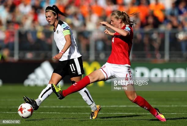 Viktoria Schnaderbeck of Austria holds off pressure from Maja Kildemoes of Denmark during the UEFA Women's Euro 2017 Semi Final match between Denmark...