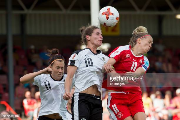 Viktoria Schnaderbeck of Austria Nina Burger of Austria and Lara Dickenmann of Switzerland battle for the ball during the Group C match between...
