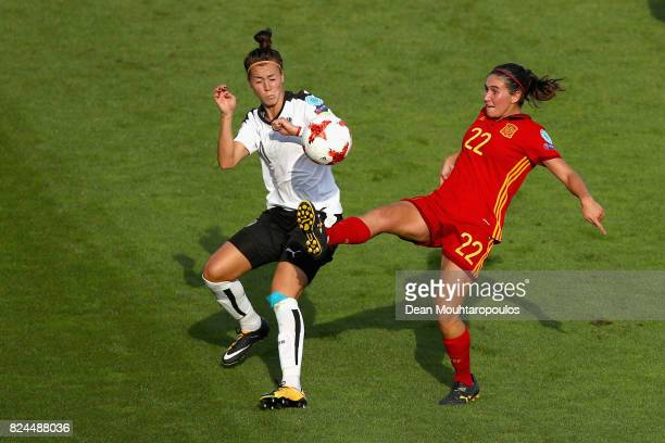 Viktoria Schnaderbeck of of Austria and Mariona Caldentey of Spain battle for possession during the UEFA Women's Euro 2017 Quarter Final match...