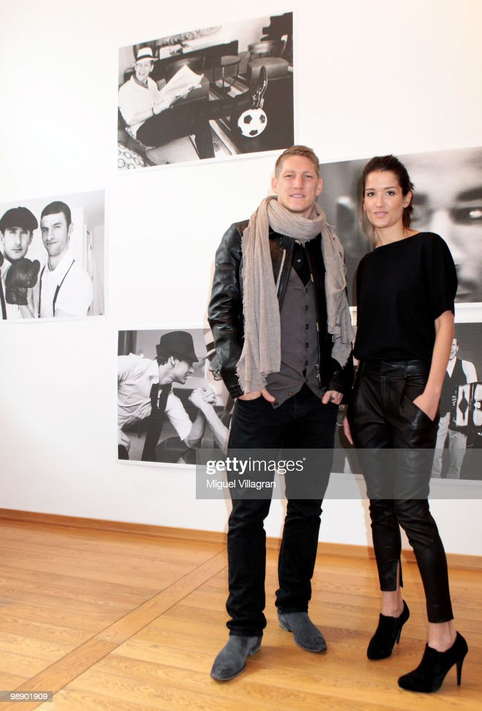 Viktoria Strehle (R) and German football player <a gi-track='captionPersonalityLinkClicked' href=/galleries/search?phrase=Bastian+Schweinsteiger&family=editorial&specificpeople=203122 ng-click='$event.stopPropagation()'>Bastian Schweinsteiger</a> attend the Strenesse book presentation 'Die Spieler' by German photographer Ellen von Unwerth on May 7, 2010 in Munich, Germany.