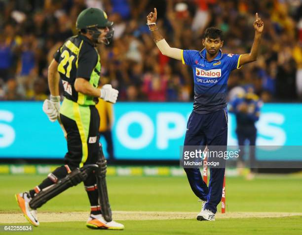 Vikum Sanjay of Sri Lanka celebrates the wicket of Moises Henriques of Australia during the first International Twenty20 match between Australia and...