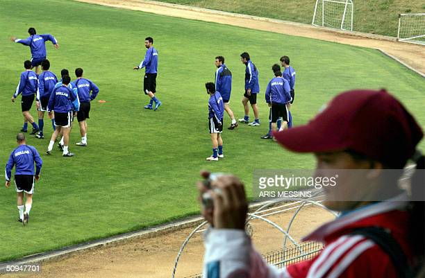 A young Benfica fan takes pictures during a training session of the Greek players at the Rio Ave stadium in Vila Do Conde 10 June 2004 two days...