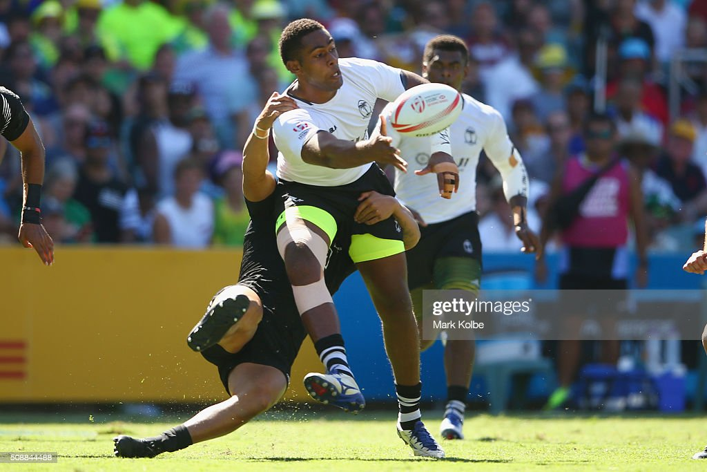 Viliame Mata of Fiji passes as he is tackled during the 2016 Sydney Sevens cup semi final match between New Zealand and Fiji at Allianz Stadium on February 7, 2016 in Sydney, Australia.