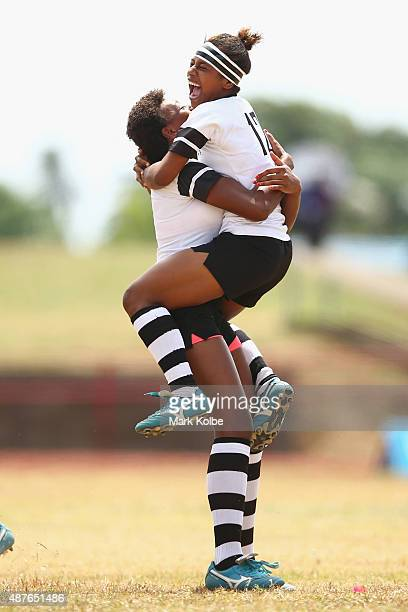 Vilisi Randai and Loyola Veitoyaki of Fiji celebrate after defeating the Cook Islands in the girls rugby sevens bronze medal match at the Apia Park...
