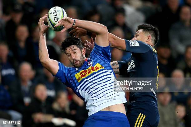 EW Viljoen of the Western Stormers fights for the ball with Rob Thompson of the Otago Highlanders during the Super Rugby match between the Otago...