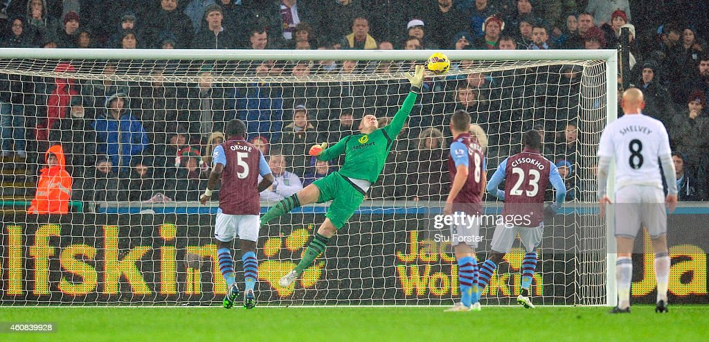 Villa goalkeeper <a gi-track='captionPersonalityLinkClicked' href=/galleries/search?phrase=Brad+Guzan&family=editorial&specificpeople=662127 ng-click='$event.stopPropagation()'>Brad Guzan</a> is beaten by a free kick from Gylfi Sigurdsson (not pictured) for the first goal during the Barclays Premier League match between Swansea City and Aston Villa at Liberty Stadium on December 26, 2014 in Swansea, Wales.
