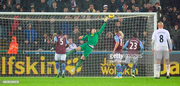 Villa goalkeeper Brad Guzan is beaten by a free kick from Gylfi Sigurdsson for the first goal during the Barclays Premier League match between...
