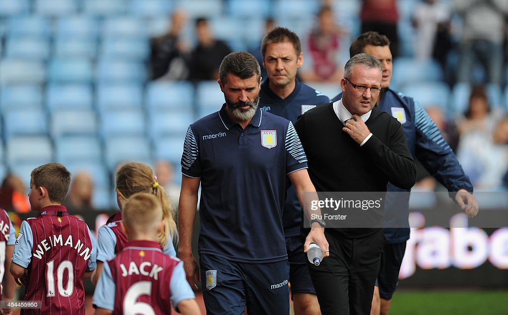 Villa manager Paul Lambert (r) with assistant Roy Keane before the Barclays Premier League match between Aston Villa and Hull City at Villa Park on August 31, 2014 in Birmingham, England.