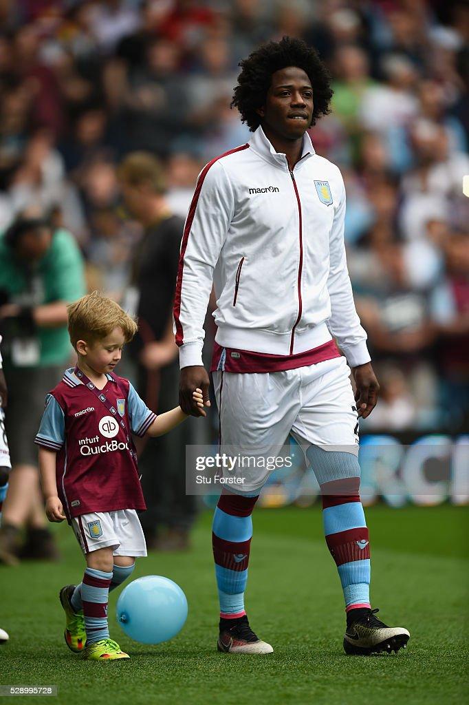 Villa player Carlos Sanchez and mascott take the field before the Barclays Premier League match between Aston Villa and Newcastle United at Villa...