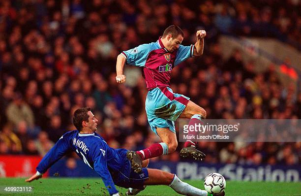 Villa striker Gilles De Bilde jumps over the challenge of Slavisa Jokanovic during the Premiership match between Chelsea and Aston Villa at Stamford...