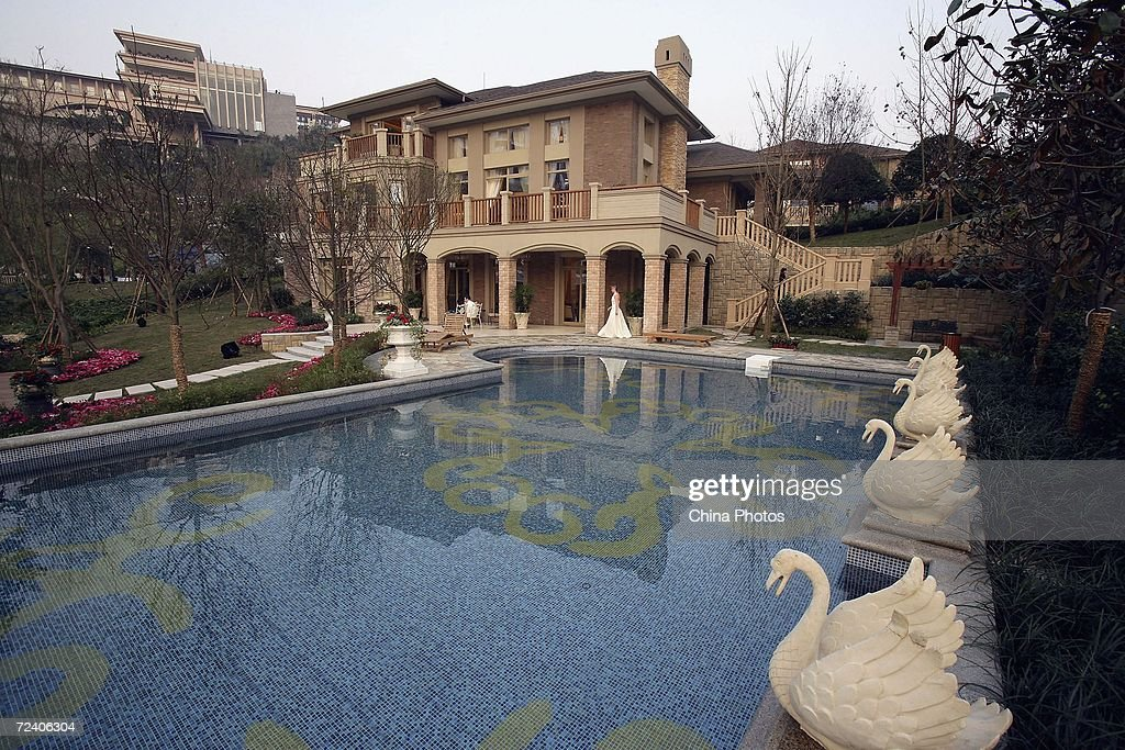 A villa with a swimming pool is seen during the opening ceremony of Chongqing Palm Springs Garden villa on November 3 2006 in Chongqing Municipality...